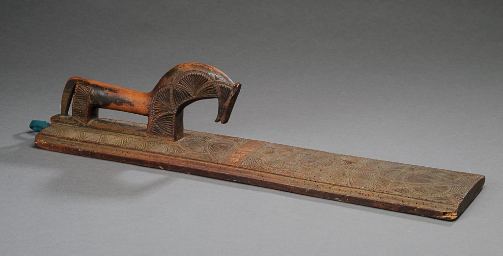Mangle board with a stylized horse, dated 1774 (private collection)